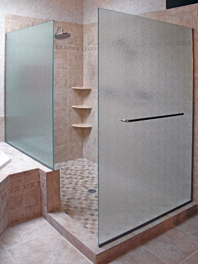 frameless shower door with panels on knee wall